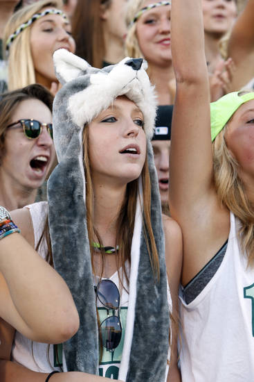 Timberwolf fan Bailey Smith, senior, watches as the Norman High School Tiger football team plays Norman North Timberwolves at Gaylord Family/Oklahoma Memorial Stadium on Thursday, Aug. 30, 2012 in Norman, Okla.  Photo by Steve Sisney, The Oklahoman