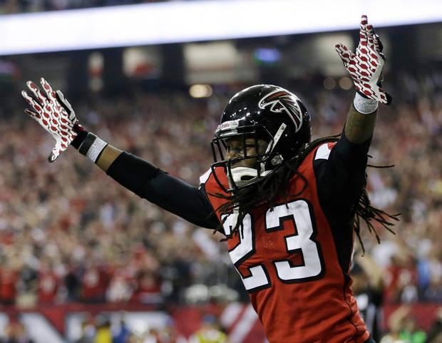 Atlanta Falcons' Dunta Robinson celebrates after stripping the ball from San Francisco 49ers' Michael Crabtree during the second half of the NFL football NFC Championship game Sunday, Jan. 20, 2013, in Atlanta. (AP Photo/David Goldman)