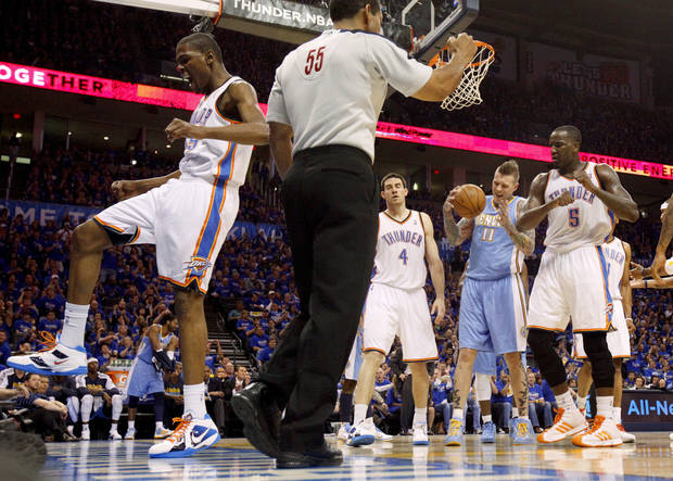 Oklahoma City's Kevin Durant (35) celebrates beside Nick Collison (4), Denver's Chris Andersen (11), and Oklahoma City's Kendrick Perkins (5) during the NBA basketball game between the Denver Nuggets and the Oklahoma City Thunder in the first round of the NBA playoffs at the Oklahoma City Arena, Sunday, April 17, 2011. Photo by Bryan Terry, The Oklahoman