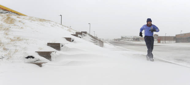"Bruce Kalish didn't let high winds and drifting snow keep him from his daily Three mile run on Baptist Road in Monument, Colo. Tuesday, April 9, 2013. Not surprisingly Kalish called himself an ""Addicted Runner.""     (AP Photo/The Colorado Springs Gazette, Mark Reis)"