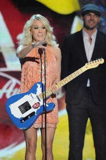 Carrie Underwood accepts the award for Female Artist of the Year during the American Country Awards on Monday, Dec. 10, 2012, in Las Vegas. (AP file)