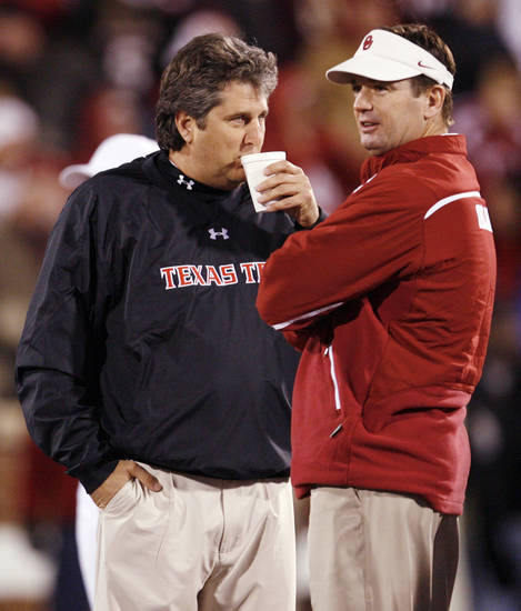 Texas Tech head coach Mike Leach, left, and OU head coach Bob Stoops talk before the college football game between the University of Oklahoma Sooners and Texas Tech University at Gaylord Family -- Oklahoma Memorial Stadium in Norman, Okla., Saturday, Nov. 22, 2008. BY NATE BILLINGS, THE OKLAHOMAN