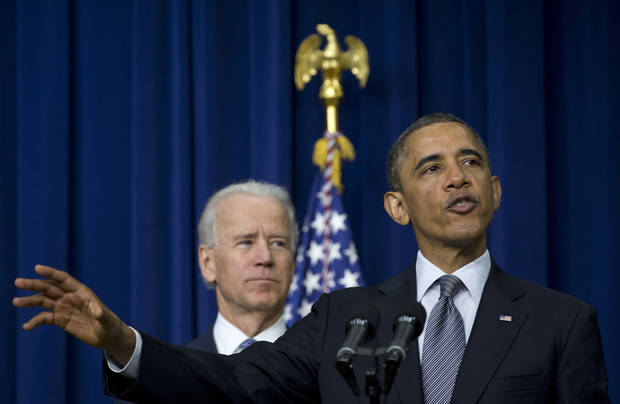 President Barack Obama, accompanied by Vice President Joe Biden, gestures as he talks about proposals to reduce gun violence, Wednesday, Jan. 16, 2013, in the South Court Auditorium at the White House in Washington. (AP Photo/Carolyn Kaster) ORG XMIT: DCCK101