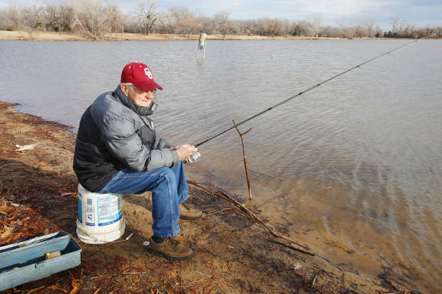 L.D. Brandon, of Midwest City, fishes for trout at Dolese Youth Park Lake in Oklahoma City. Photo by Paul B. Southerland, The Oklahoman <strong>PAUL B. SOUTHERLAND - PAUL B. SOUTHERLAND</strong>