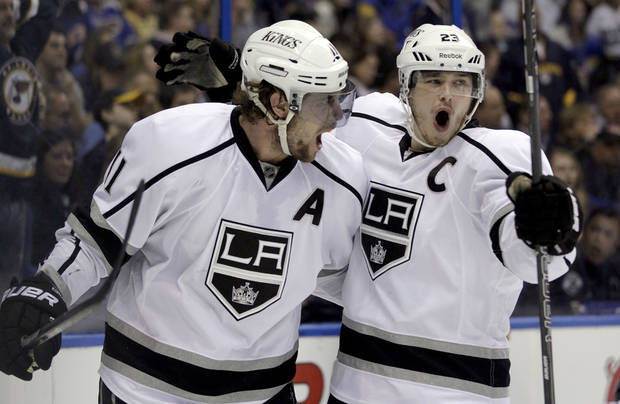 Los Angeles Kings' Anze Kopitar, left, of Slovenia, is congratulated by Dustin Brown after scoring during the first period in Game 2 of an NHL hockey Stanley Cup second-round playoff series against the St. Louis Blues, on Monday, April 30, 2012, in St. Louis. (AP Photo/Jeff Roberson)