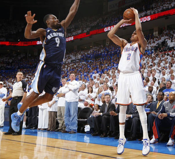 Oklahoma City's Thabo Sefolosha shoots the ball as Memphis' Tony Allen defends during Game 2 in the second round of the NBA playoffs between the Oklahoma City Thunder and the Memphis Grizzlies at Chesapeake Energy Arena In Oklahoma City, Tuesday, May 7, 2013. Photo by Bryan Terry, The Oklahoman