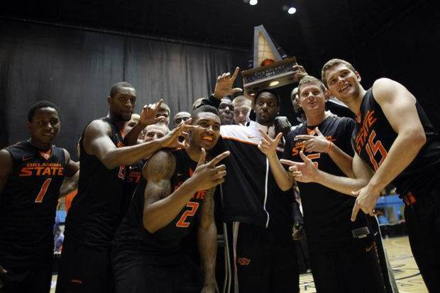 OSU celebrates the Puerto Rico Tip-Off championship. / AP photo