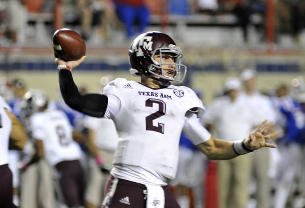   Texas A&amp;M Quarterback Johnny Manziel threw for 395 yards during an NCAA football game in Shreveport, La.,Saturday, Oct. 13, 2012. (AP Photo/Kita K Wright)  