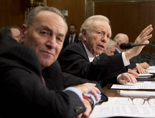 Sens. Charles Schumer, D-N.Y., from left and Joe Lieberman, I-Conn., look towards pictures, not shown, of the devastations in Connecticut from Hurricane Sandy during a Senate Appropriations Subcommittee on Department of Homeland Security hearing, to examine Hurricane Sandy, focusing on response and recovery and progress and challenges on Capitol Hill in Washington, Wednesday, Dec. 5, 2012.    (AP Photo/Manuel Balce Ceneta)