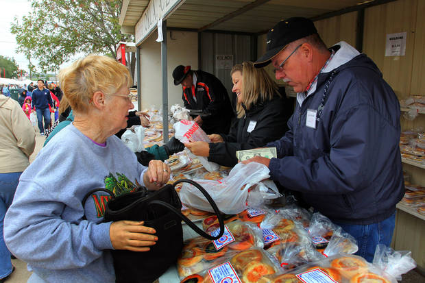 John Parizek counts change to give to Marge Hester after she purchased kolaces during the 47th annual Czech Festival Saturday in Yukon. PHOTO BY HUGH SCOTT FOR THE OKLAHOMAN