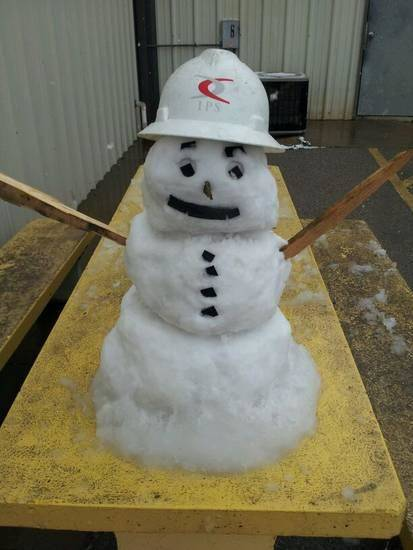 Snowman safely working