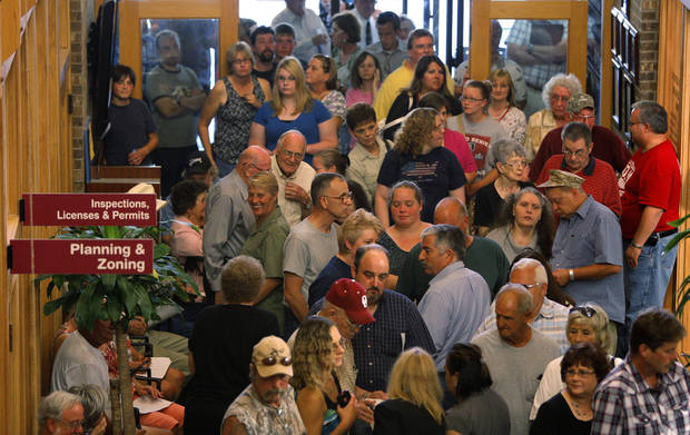 Del CIty residents pack the city hall before a Del City Planning Commission meeting to consider a zone change allowing Howard Memorial Baptist Church to become a halfway house on Thursday, June 28, 2012. photo by Bryan Terry, The Oklahoman