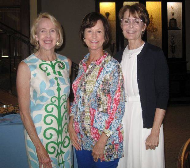 Christy Everest, Leslie Regens and Susan Hoffman talk at the  baby shower. (Photo by Helen Ford Wallace).