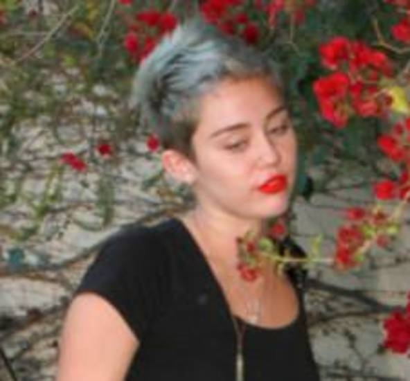Miley's new hair color. She says it's platinum; everyone else thinks it's blue.