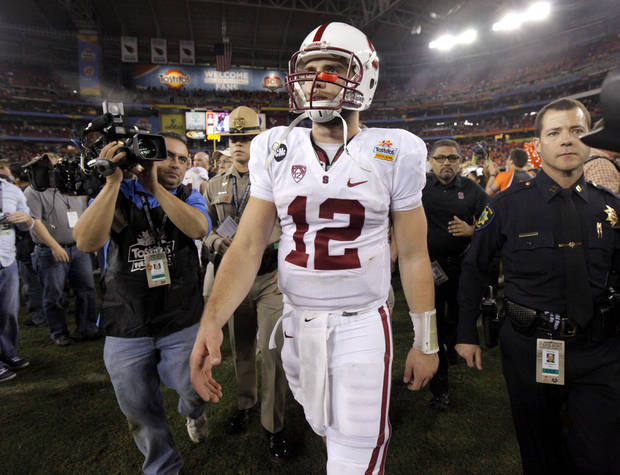 Stanford's Andrew Luck (12) walks of the field after losing the Fiesta Bowl between the Oklahoma State University Cowboys (OSU) and the Stanford Cardinal at the University of Phoenix Stadium in Glendale, Ariz., Tuesday, Jan. 3, 2012. Photo by Bryan Terry, The Oklahoman