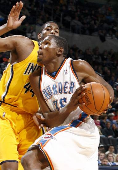 Oklahoma City's Kevin Durant (35) drives to the basket as Indiana's Solomon Jones (44) defends during the basketball game between the Oklahoma City Thunder and the Indiana Pacers, Saturday, Jan. 9, 2010 at the Ford Center in Oklahoma CIty. Photo by Sarah Phipps, The Oklahoman