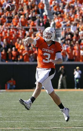 OSU's Brandon Weeden throws a pass during the college football game between the Oklahoma State University Cowboys (OSU) and the Baylor University Bears at Boone Pickens Stadium in Stillwater, Okla., Saturday, Nov. 6, 2010. Photo by Sarah Phipps, The Oklahoman