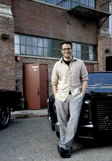 Seth Rogen poses with the Black Beauty car at Comic-Con International 2010.