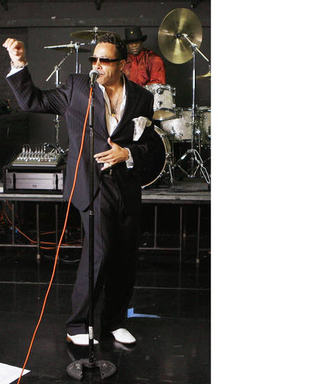 Morris Day performs in 2008 with The Time at a Hollywood rehearsal studio in Los Angeles. AP photo