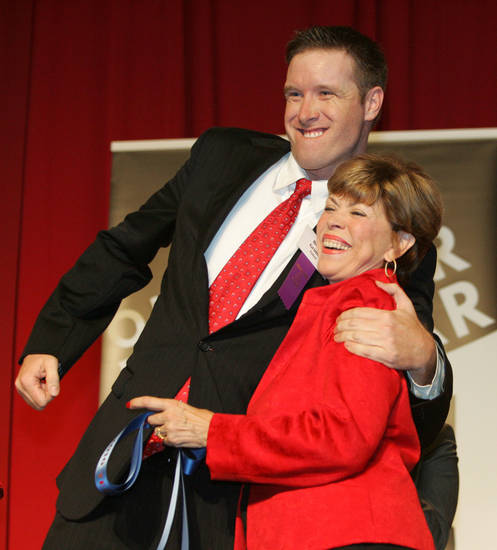 Oklahoma's Teacher of the Year Brian Grimm hugs Sandy Garrett, state superintendent of public instruction after the announcement was made at The Oklahoma State Fair at State Fair Park in Oklahoma City, Oklahoma September 22, 2009. Photo by Steve Gooch, The Oklahoman