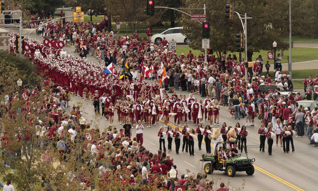 "The ""Pride"" marching band marches down Boyd Street during the homecoming parade before the University of Oklahoma Sooners (OU) game with the Texas Tech University Red Raiders (TTU) on Saturday, Oct. 22, 2011. in Norman, Okla. Photo by Steve Sisney, The Oklahoman"