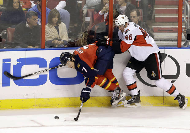 Florida Panthers defenseman Dmitry Kulikov (7), of Russia, and Ottawa Senators defenseman Patrick Wiercioch (46) battle for the puck during the second period of an NHL hockey game, Thursday, Jan. 24, 2013, in Sunrise, Fla. (AP Photo/Wilfredo Lee)