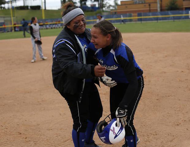 Little Axe's Andee Frazier runs to greet Reagan McDoulett (16) after she made the game-winning run during the 3A OSSAA Championship softball game between Little Axe and Sequoyah at ASA Hall of Fame Stadium in Oklahoma City, Saturday, Oct. 6, 2012.  Photo by Garett Fisbeck, The Oklahoman
