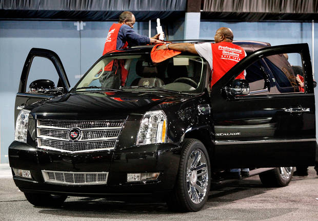 Men with Professional Detailers of Oklahoma City get a Cadillac Escalade Hybrid all shined up for the show. Workers stayed busy most of Tuesday, Mar. 1, 2011. setting up displays and placing cars  in the right spots in preparation for this week's Auto Show at State Fair Park.   Photo by Jim Beckel, The Oklahoman