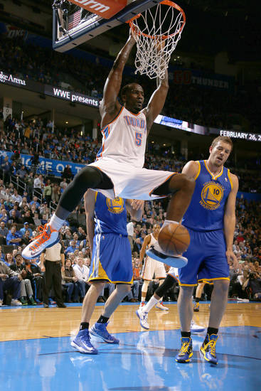 Oklahoma City's Kendrick Perkins (5) dunks the ball beside Golden State's David Lee (10) during an NBA basketball game between the Oklahoma City Thunder and the Golden State Warriors at Chesapeake Energy Arena in Oklahoma City, Wednesday, Feb. 6, 2013. Photo by Bryan Terry, The Oklahoman