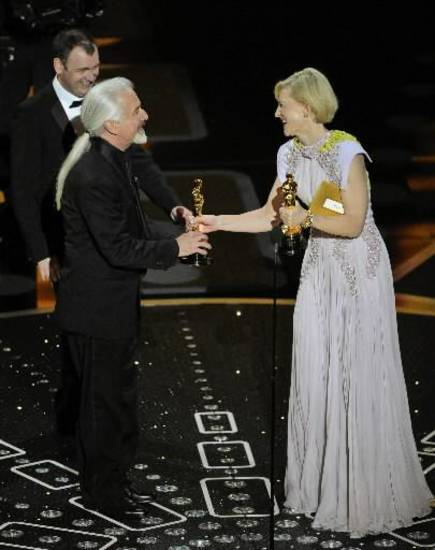 "Cate Blanchett presents Rick Baker and Dave Elsey with the best makeup award for ""The Wolfman."""