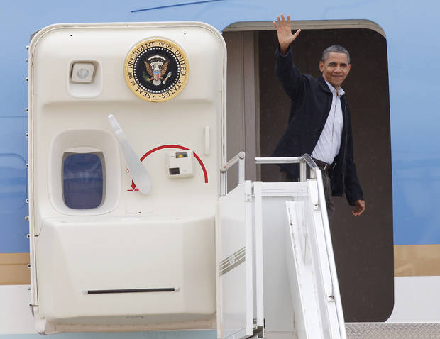 President Barack Obama waves from Air Force One as he departing from Tinker Air Force Base in Oklahoma City, Thursday,  March 22, 2012.  Photo By David McDaniel/The Oklahoman