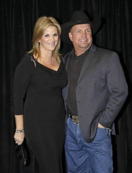 Garth Brooks, right, and Trisha Yearwood arrive for the Nashville Songwriters Hall of Fame inductions on Sunday, Oct. 7, 2012, in Nashville, Tenn.