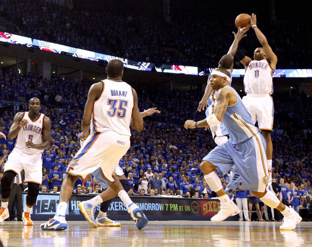 Oklahoma City's Russell Westbrook (0) puts a shot in the final seconds over Denver's Raymond Felton (20) and Kenyon Martin (4) during the NBA basketball game between the Denver Nuggets and the Oklahoma City Thunder in the first round of the NBA playoffs at the Oklahoma City Arena, Sunday, April 17, 2011. Photo by Bryan Terry, The Oklahoman