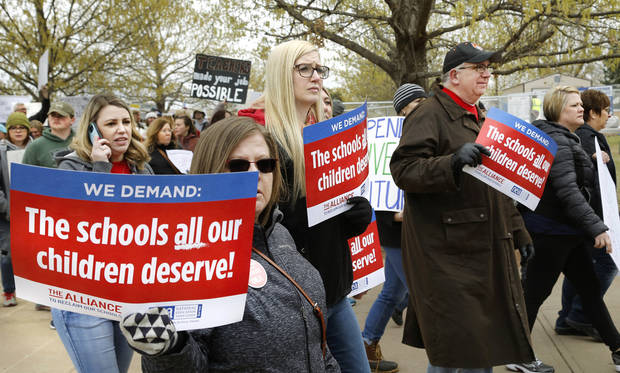 Teachers from throughout the state converged at the Capitol to bring their concerns about education funding to the attention of legislators and state officials during the first day of a statewide public schools teacher walkout  on Monday, April 2, 2018. Photo by Jim Beckel, The Oklahoman