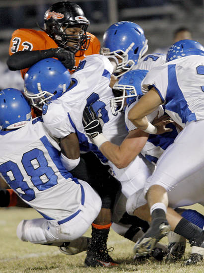 Glenpool's defense combine to stop Douglass' Erik King (CQ) ERIK during their game at Moses F. Miller Stadium at Douglass High School in Oklahoma City on Friday, Oct. 29, 2010. Photo by John Clanton, The Oklahoman