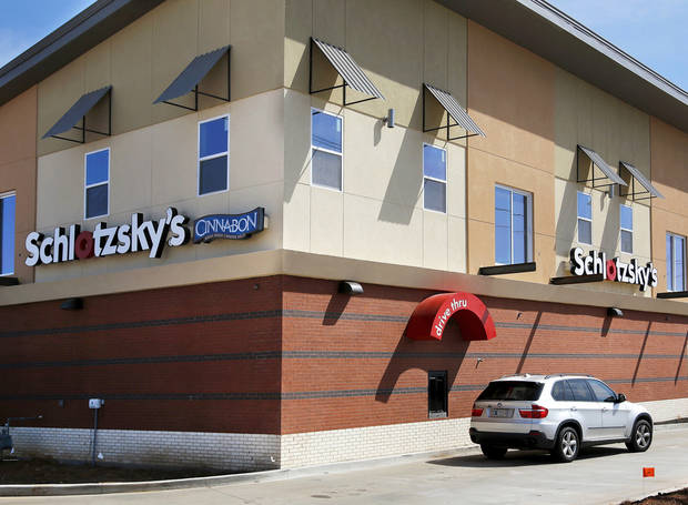Midwest City�s new Schlotzsky�s features upscale apartments above and a slanted roof, meant to invoke the look of an airplane.