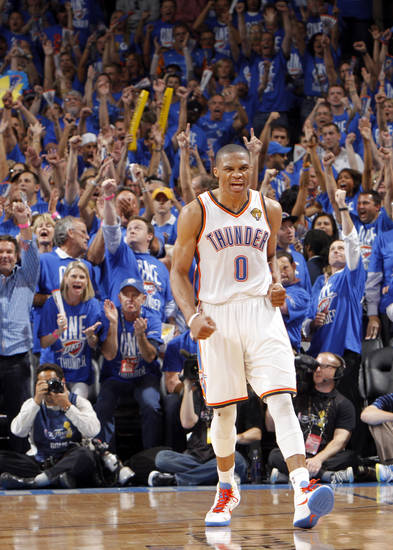 Oklahoma City's Russell Westbrook (0) reacts after a three point shot during Game 1 of the NBA Finals between the Oklahoma City Thunder and the Miami Heat at Chesapeake Energy Arena in Oklahoma City, Tuesday, June 12, 2012. Photo by Chris Landsberger, The Oklahoman