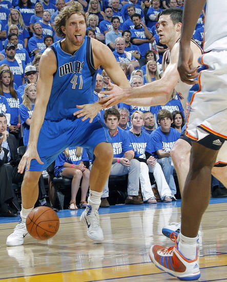 Dirk Nowitzki (41) of Dallas drives against Oklahoma City's Nick Collison (4) during game 3 of the Western Conference Finals of the NBA basketball playoffs between the Dallas Mavericks and the Oklahoma City Thunder at the OKC Arena in downtown Oklahoma City, Saturday, May 21, 2011. Photo by Chris Landsberger, The Oklahoman
