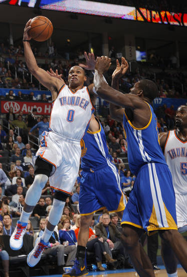 Oklahoma City 's Russell Westbrook (0) takes a shot during an NBA basketball game between the Oklahoma City Thunder and the Golden State Warriors at Chesapeake Energy Arena in Oklahoma City, Sunday, Nov. 18, 2012.  Photo by Garett Fisbeck, The Oklahoman
