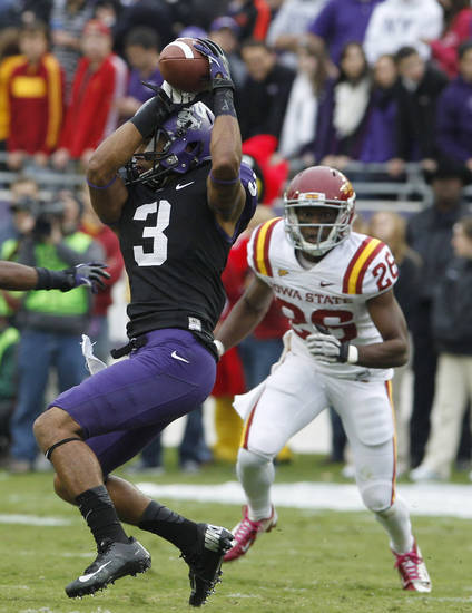 TCU wide receiver Brandon Carter (3) catches a pass in front of Iowa State defensive back Deon Broomfield (26) during the first half of an NCAA college football game on Saturday, Oct. 6, 2012, in Fort Worth, Texas. (AP Photo/LM Otero)