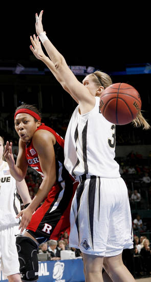 Rurgers' Brittany Ray passes the ball around Purdue's Natasha Bogdanova during the NCAA women's basketball tournament game between Rutgers and Purdue at the Ford Center in Oklahoma City, Sunday, March 29, 2009.  PHOTO BY BRYAN TERRY, THE OKLAHOMAN