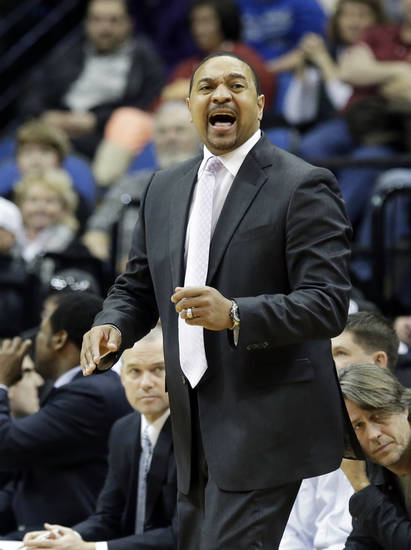 Golden State Warriors head coach Mark Jackson yells instructions in the second half of an NBA basketball game against the Minnesota Timberwolves Sunday, Feb. 24, 2013, in Minneapolis. Golden State won 100-99. (AP Photo/Jim Mone)