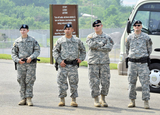 U.S. soldiers stand guard while South Korean technicians conduct a ground-penetrating radar survey of alleged burial of a highly toxic defoliant at Camp Carroll.