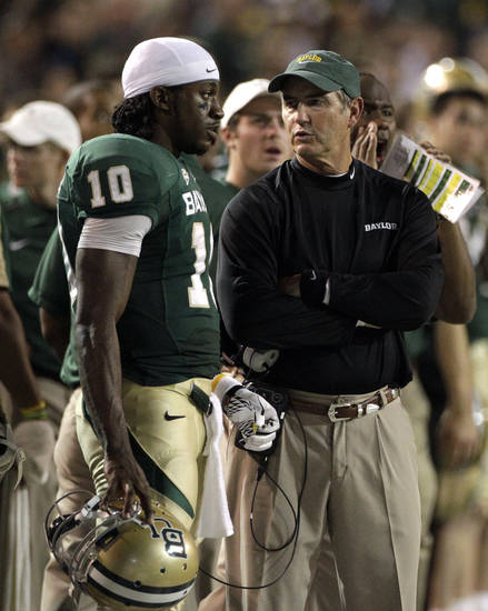 Baylor head coach Art Briles, right, talks with quarterback Robert Griffin III in the second half of an NCAA college football game against Oklahoma Saturday, Nov. 19, 2011, in Waco, Texas. Baylor won 45-38. (AP Photo/Tony Gutierrez) ORG XMIT: TXTG222