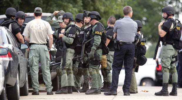 Oklahoma City police SWAT team assembles at a command post set up on Miller Avenue just north of NW 37 Street Monday, August 30, 2010. A female Oklahoma City police officer was shot in her patrol car on Miller Ave. just south of NW 39 Street. Photo by Paul B. Southerland, The Oklahoman 
