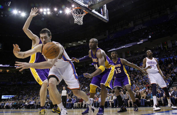 Oklahoma City's Nick Collison (4) and Lakers' Kobe Bryant (24) chase down a loose ball during the NBA basketball game between the Oklahoma City Thunder and the Los Angeles Lakers, Sunday, Feb. 27, 2011, at the Oklahoma City Arena.Photo by Sarah Phipps, The Oklahoman
