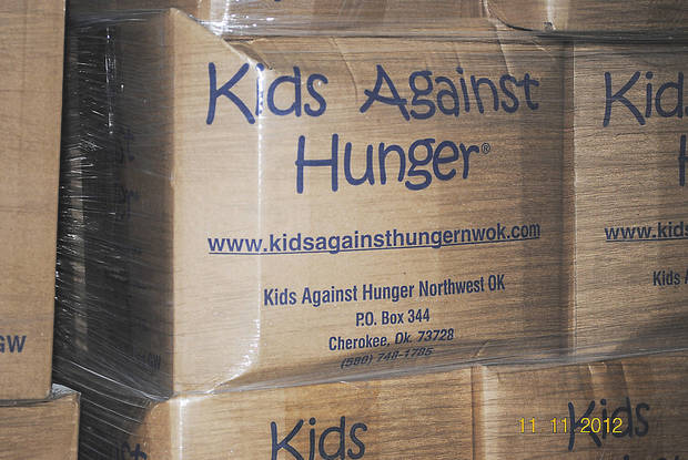 A box containing food items collected and packaged in the Cherokee satellite office of Kids Against Hunger is seen in this photo. The food, stored in Haiti, will provide meals for children there. <strong> - Provided</strong>