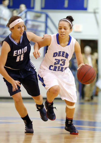 Deer Creek's Ashley Gibson dribbles past Enid's Abby Lee during the girls high school basketball game between Enid and Deer Creek at the Bruce Gray Invitational at Deer Creek High School, Saturday,Jan. 26, 2013.Photo by Sarah Phipps, The Oklahoman