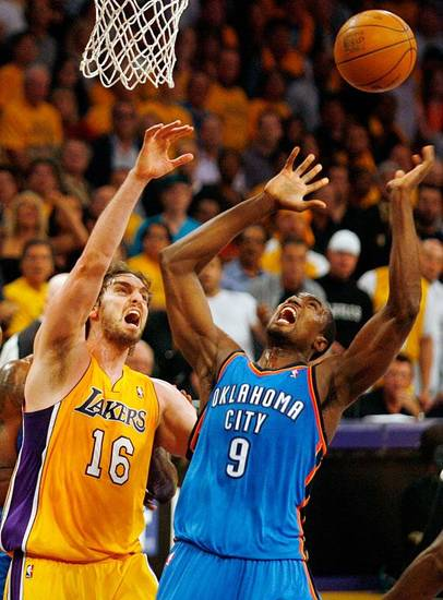 Oklahoma City's Serge Ibaka (9) and Los Angeles' Pau Gasol (16) chase a rebound during Game 3 in the second round of the NBA basketball playoffs between the L.A. Lakers and the Oklahoma City Thunder at the Staples Center in Los Angeles, Saturday, May 19, 2012. Photo by Nate Billings, The Oklahoman