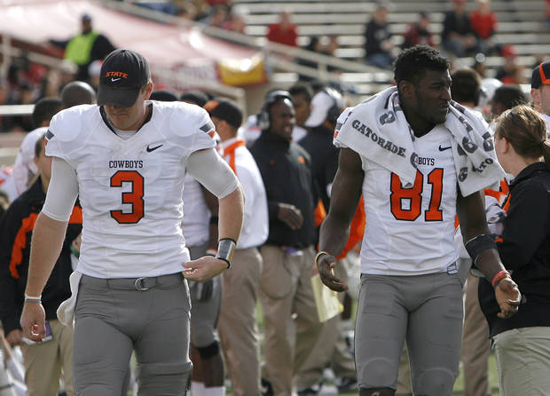 Oklahoma State's Brandon Weeden (3) and Justin Blackmon (81) walk the sideline during a college football game between Texas Tech University (TTU) and Oklahoma State University (OSU) at Jones AT&T Stadium in Lubbock, Texas, Saturday, Nov. 12, 2011.  Photo by Sarah Phipps, The Oklahoman  ORG XMIT: KOD